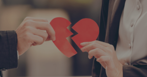 A couple holding pieces of a broken heart together