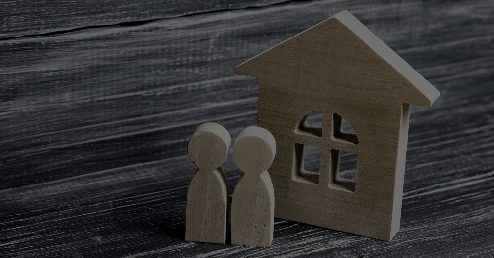 Wood cutout image of house and couple